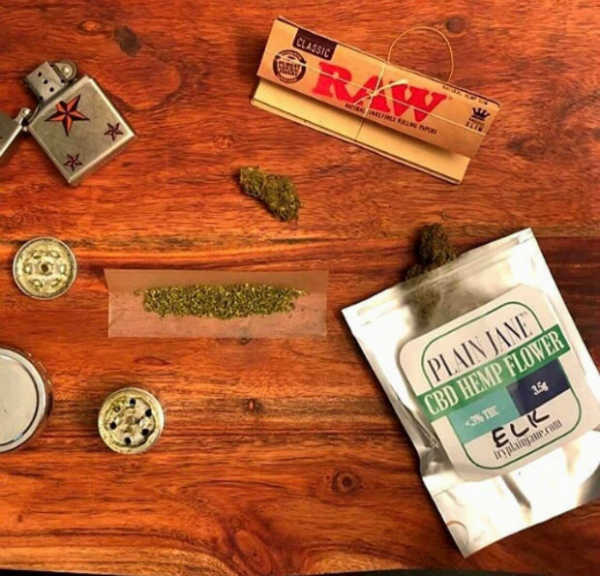 cbd hemp flower with grinder and rolling papers