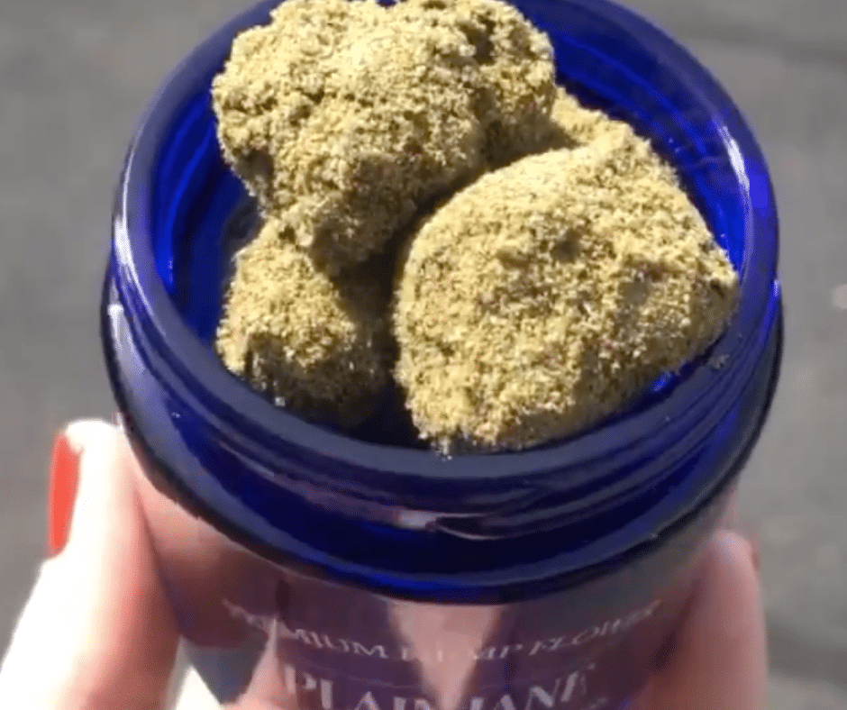 Plain Jane moon rocks in a blue glass container